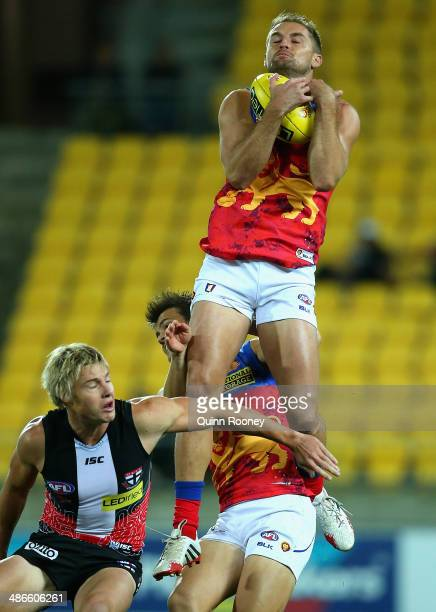 Joel Patfull of the Lions marks over the top of Clinton Jones of the Saints during the round six AFL match between the St Kilda Saints and the...