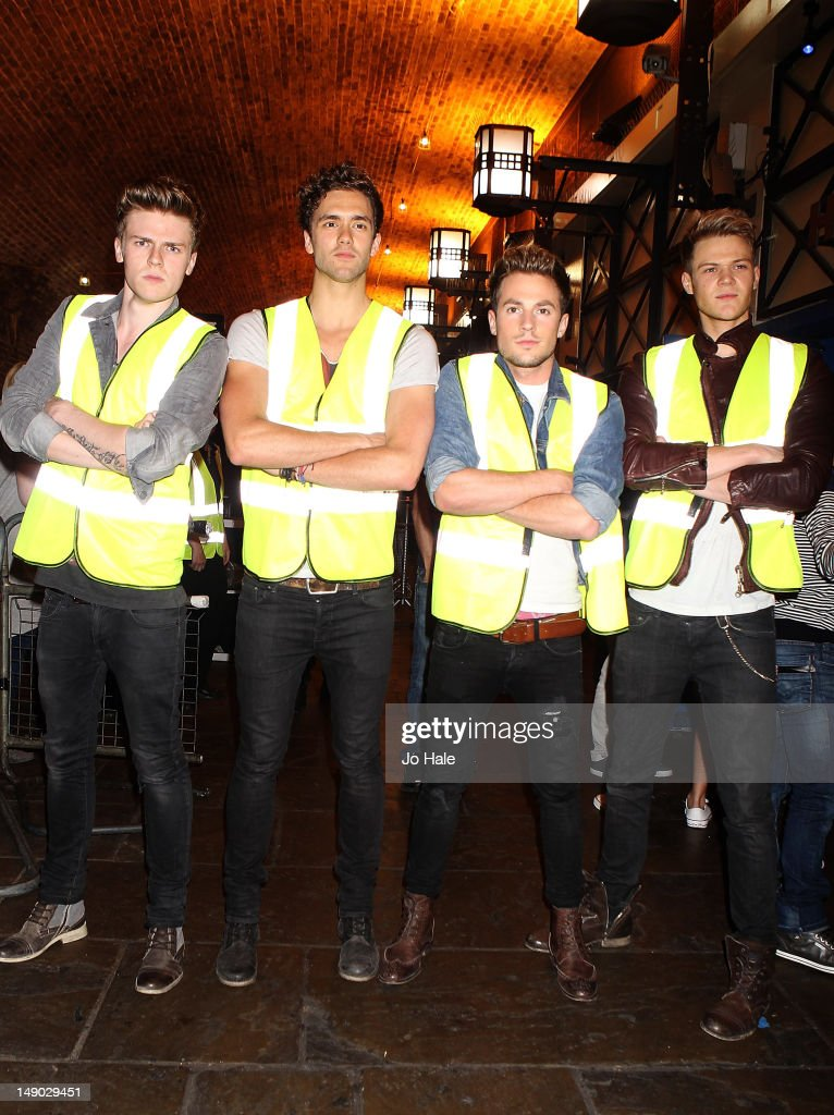 Joel Peat Andy Brown Adam Pitts and Ryan Fletcher of Lawson pose as Security Guards outside at Heaven on July 21 2012 in London United Kingdom