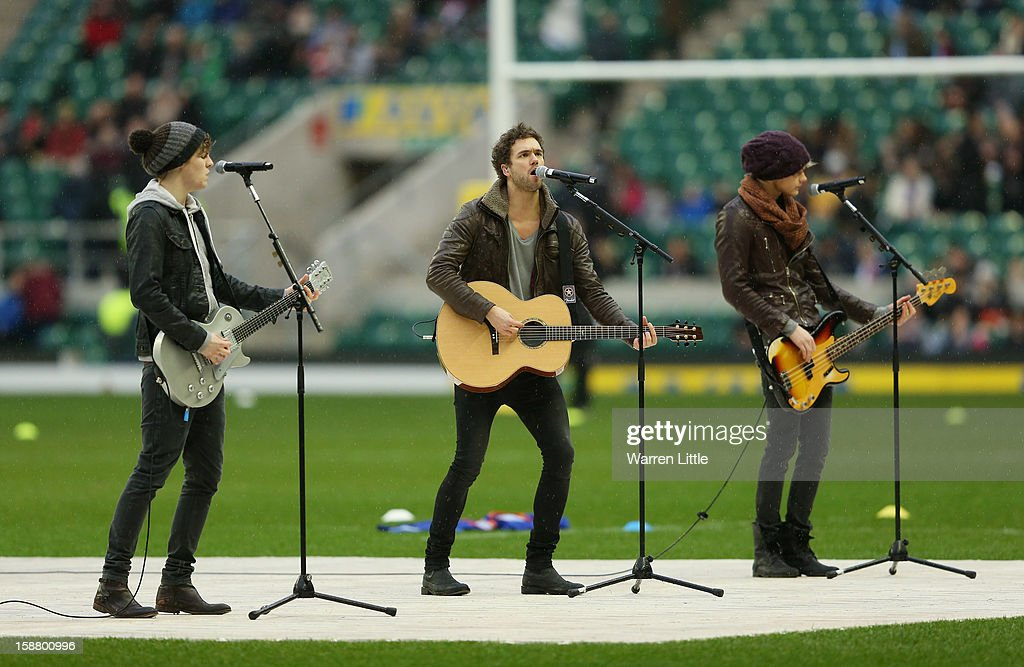 <a gi-track='captionPersonalityLinkClicked' href=/galleries/search?phrase=Joel+Peat&family=editorial&specificpeople=7078660 ng-click='$event.stopPropagation()'>Joel Peat</a>, Andy Brown and Ryan Fletcher of Lawson perform prior to the Aviva Premiership match between Harlequins and London Irish at Twickenham Stadium on December 29, 2012 in London, England.