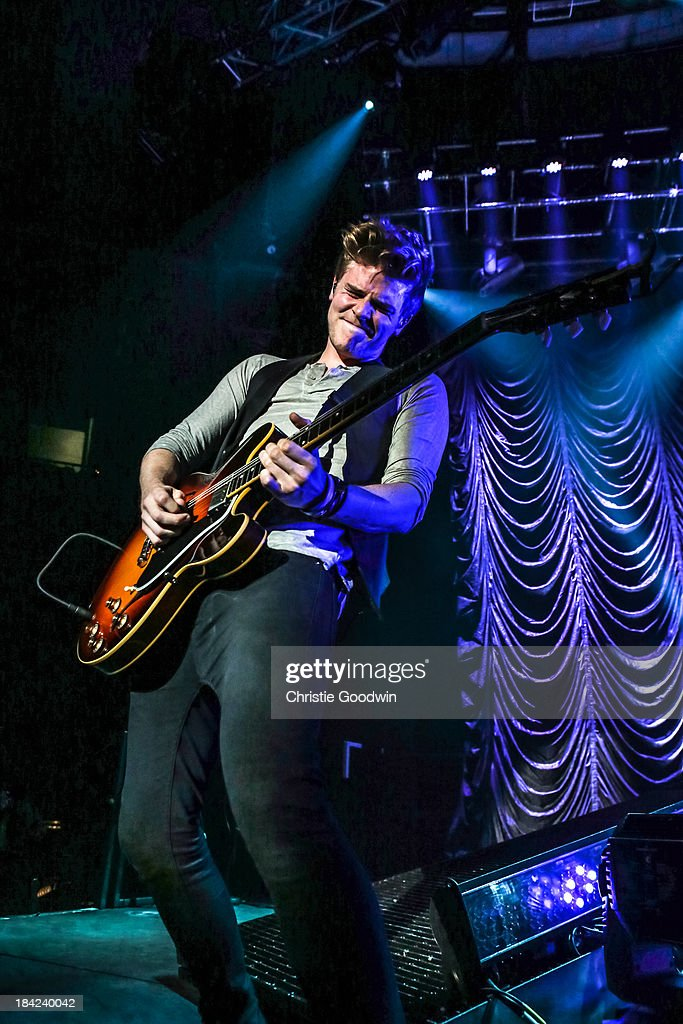 <a gi-track='captionPersonalityLinkClicked' href=/galleries/search?phrase=Joel+Peat&family=editorial&specificpeople=7078660 ng-click='$event.stopPropagation()'>Joel Peat</a> of Lawson performs on stage at The Roundhouse on October 12, 2013 in London, England.