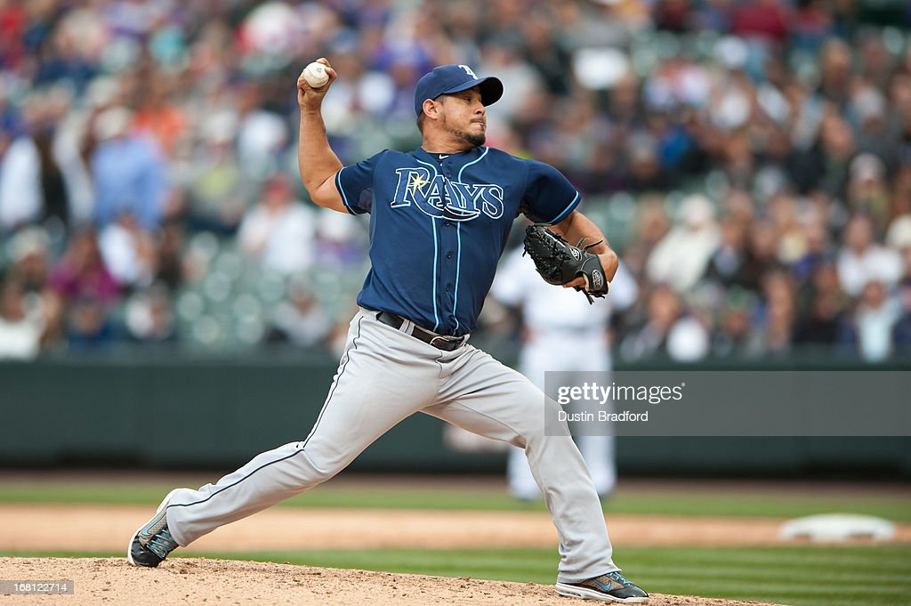 <a gi-track='captionPersonalityLinkClicked' href=/galleries/search?phrase=Joel+Peralta&family=editorial&specificpeople=581506 ng-click='$event.stopPropagation()'>Joel Peralta</a> #62 of the Tampa Bay Rays pitches against the Colorado Rockies in the eighth inning of a game at Coors Field on May 5, 2013 in Denver, Colorado.
