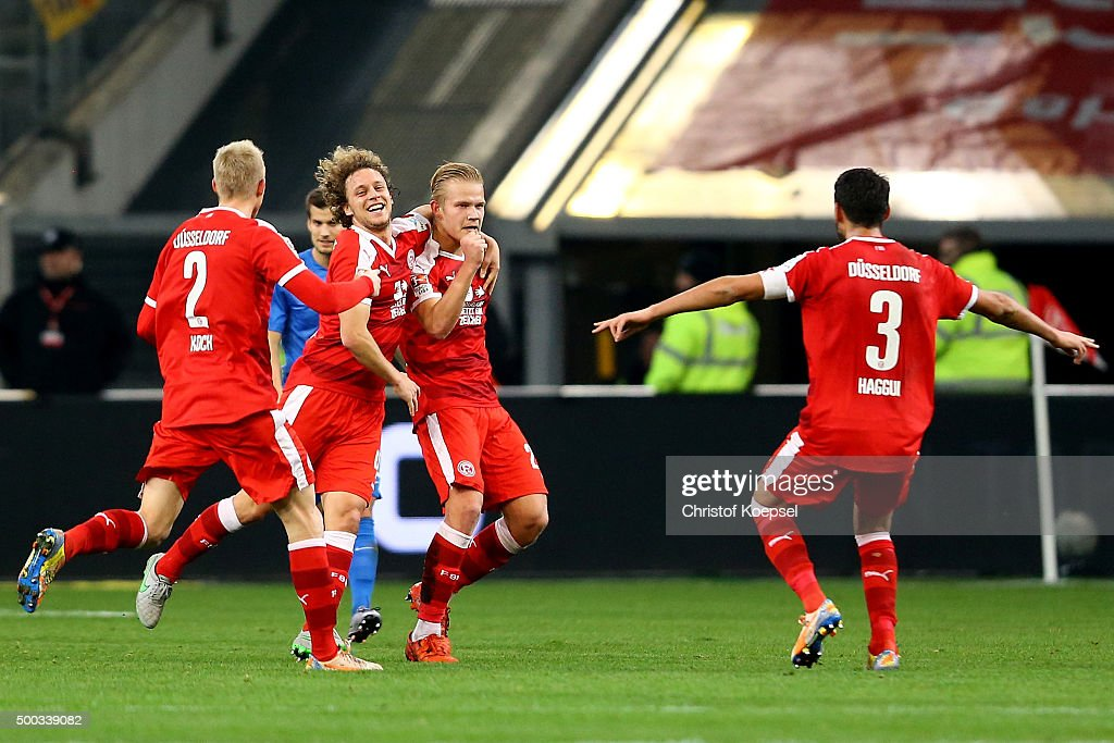 Joel Pohjanpalo of Duesseldorf celebrates the first goal with Julian Koch Julian Schauerte and Karim Haggui of Duesseldorf during the Second...