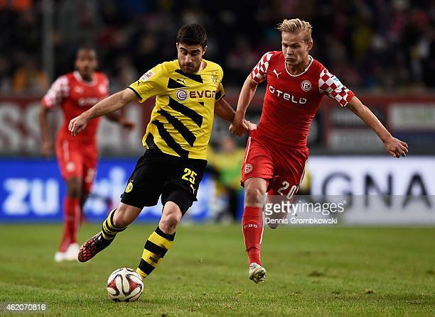 Joel Pohjanpalo of Fortuna Duesseldorf chases Sokratis of Borussia Dortmund during the friendly match between Fortuna Duesseldorf and Borussia...