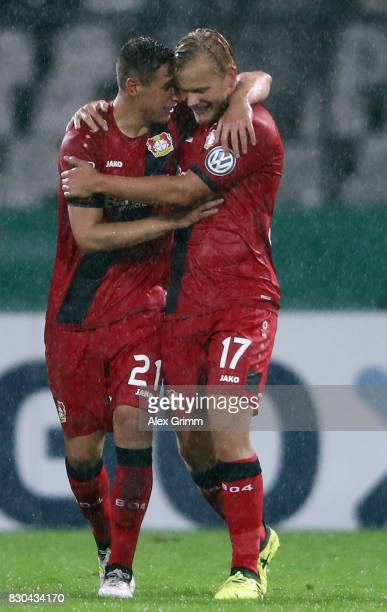 Joel Pohjanpalo of Leverkusen celebrates his team's second goal with team mate Dominik Kohr during the DFB Cup first round match between Karlsruher...