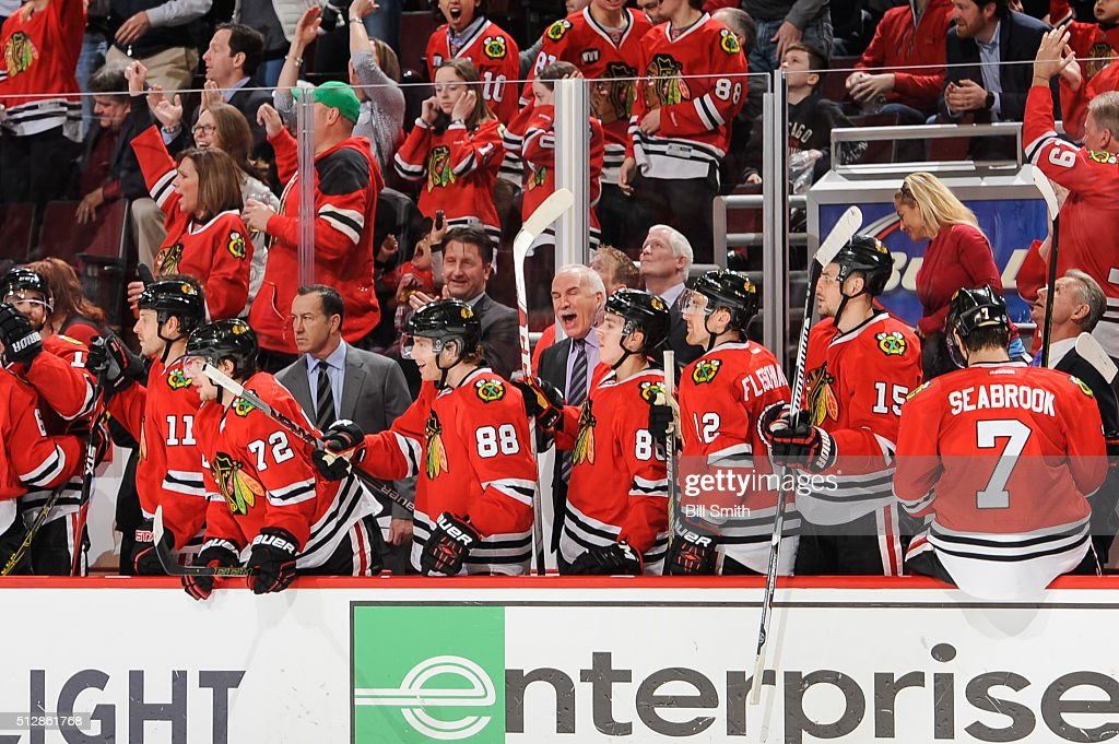 <a gi-track='captionPersonalityLinkClicked' href=/galleries/search?phrase=Joel+Quenneville&family=editorial&specificpeople=2094832 ng-click='$event.stopPropagation()'>Joel Quenneville</a>, head coach of the Chicago Blackhawks, (middle) reacts after the Blackhawks scored in the third period of the NHL game against the Washington Capitals at the United Center on February 28, 2016 in Chicago, Illinois.
