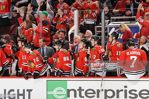 Joel Quenneville head coach of the Chicago Blackhawks reacts after the Blackhawks scored in the third period of the NHL game against the Washington...