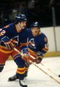 Joel Quenneville of the Colorado Rockies skates on the ice during an NHL game in February 1982