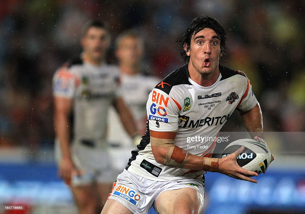 Joel Reddy of the Wests Tigers looks to pass the ball during the round four NRL match between the Manly Sea Eagles and the Wests Tigers at Bluetongue Stadium on March 28, 2013 in Gosford, Australia.