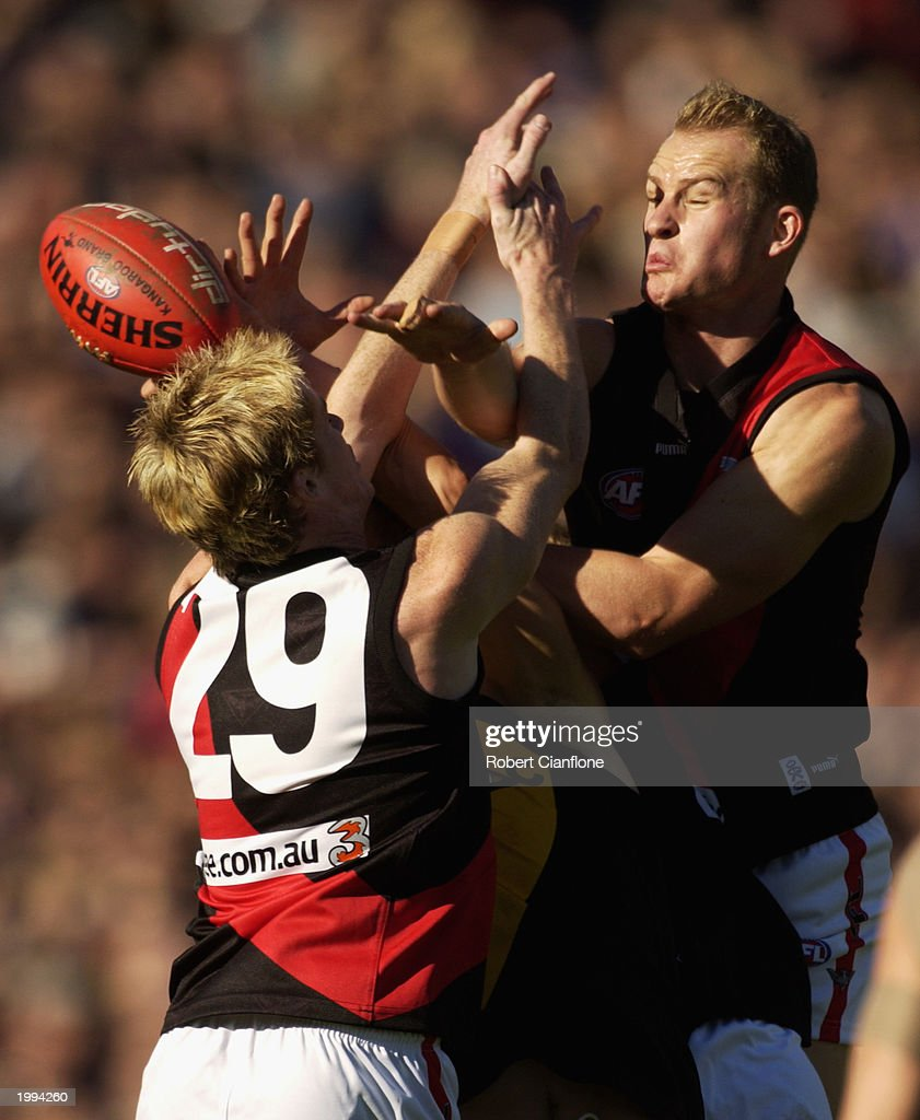 Joel Reynolds and Sean Wellman of the Bombers challenge an opponent during the round seven AFL Premiership Cup match between the Richmond Tigers and...