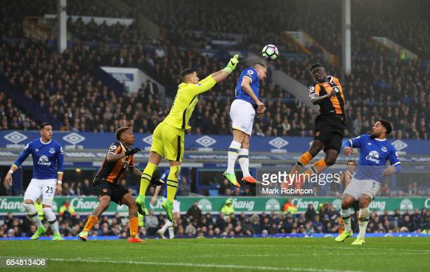 Joel Robles and Phil Jagielka of Everton jump with Alfred N'Diaye of Hull City during the Premier League match between Everton and Hull City at...