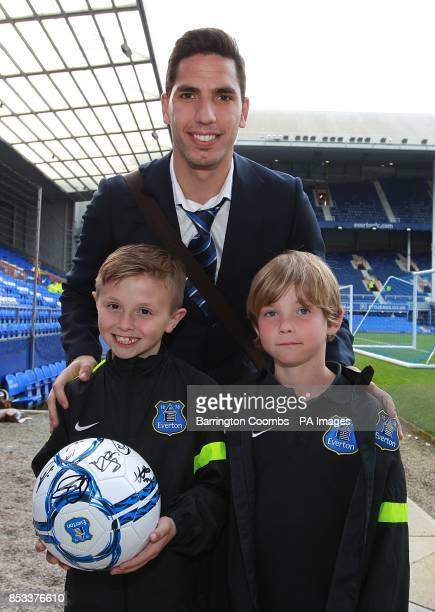 Joel Robles Everton poses with fans before the game
