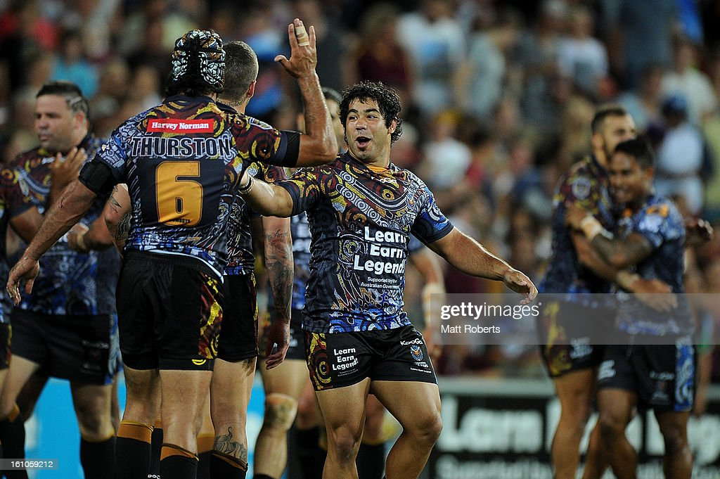 Joel Romelo of the Indigenous All Stars celebrates with tema mates a Ben Barba try during the NRL All Stars Game between the Indigenous All Stars and the NRL All Stars at Suncorp Stadium on February 9, 2013 in Brisbane, Australia.