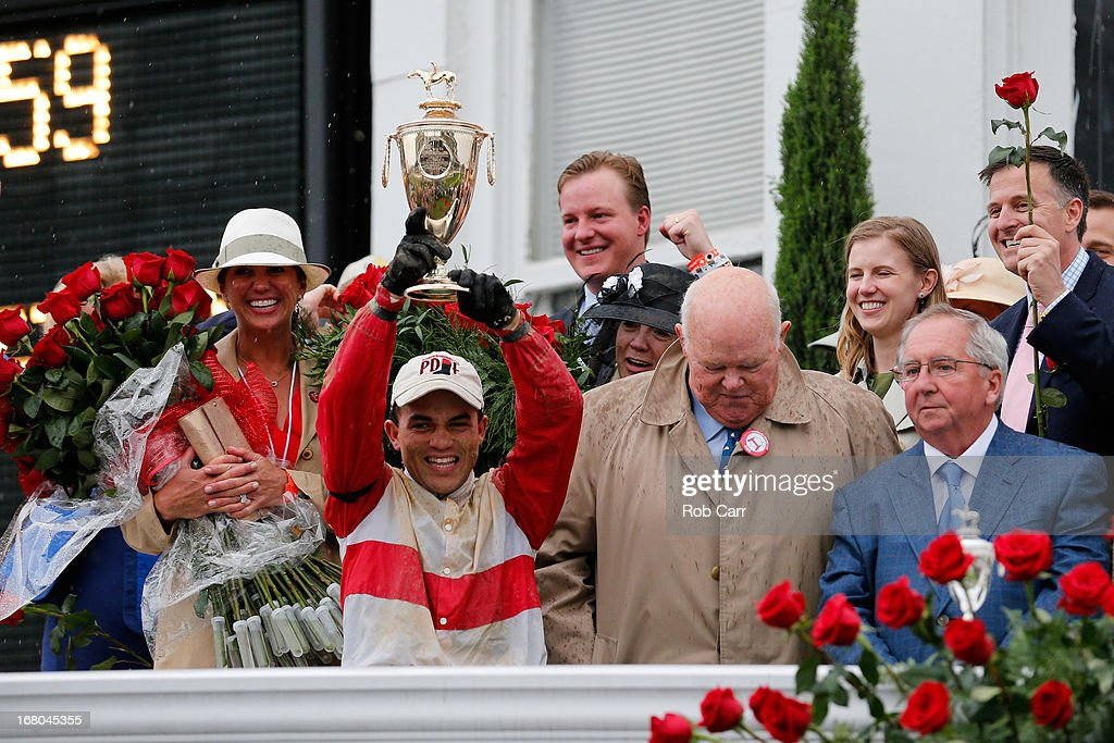 Joel Rosario atop Orb celebrates with the trophy after winning the 139th running of the Kentucky Derby at Churchill Downs on May 4, 2013 in Louisville, Kentucky.