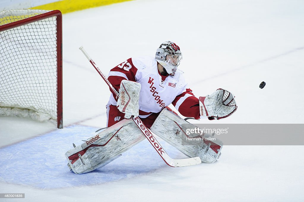 Joel Rumpel #33 of the Wisconsin Badgers makes a glove side save during the semifinal game of the Big Ten Men's Ice Hockey Championship against the Penn State Nittany Lions on March 21, 2014 at Xcel Energy Center in St Paul, Minnesota.