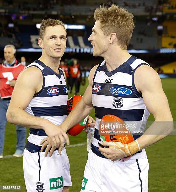Joel Selwood and brother Scott celebrate during the 2016 AFL Round 20 match between the Geelong Cats and the Essendon Bombers at Etihad Stadium on...