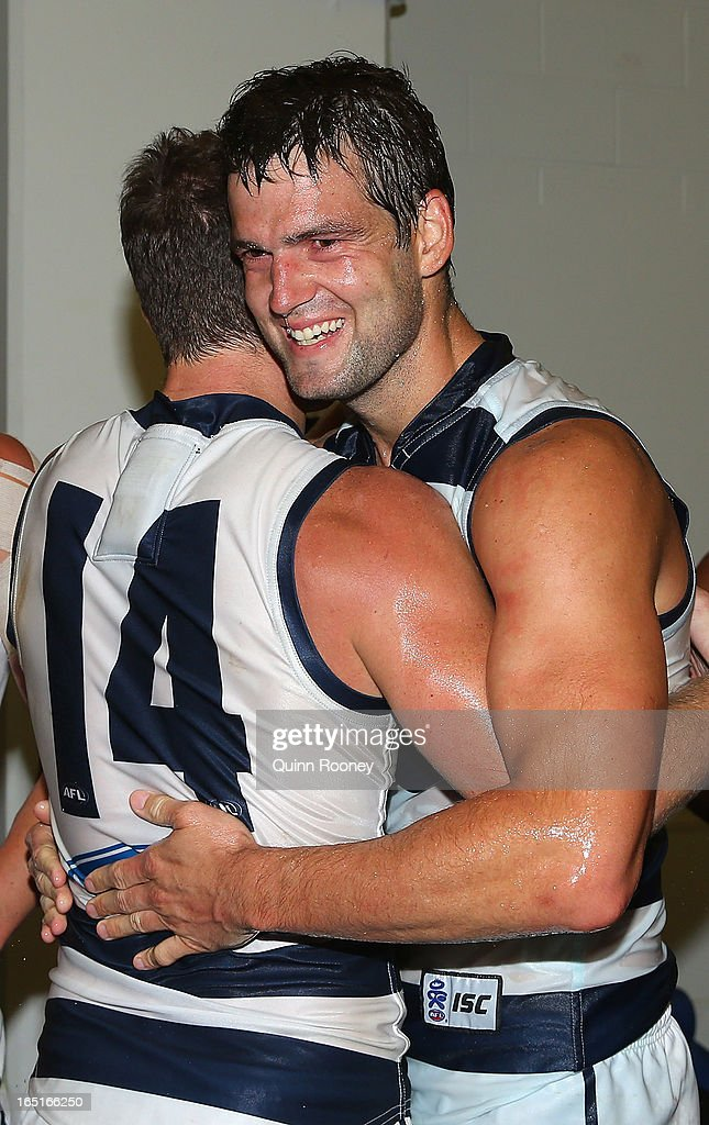 Joel Selwood and <a gi-track='captionPersonalityLinkClicked' href=/galleries/search?phrase=Jared+Rivers&family=editorial&specificpeople=221112 ng-click='$event.stopPropagation()'>Jared Rivers</a> of the Cats celebrate in the rooms after winning the round one AFL match between the Hawthorn Hawks and the Geelong Cats at the Melbourne Cricket Ground on April 1, 2013 in Melbourne, Australia.