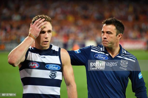 Joel Selwood of the Cats and Cats head coach Chris Scott look on dejected after the First AFL Preliminary Final match between the Adelaide Crows and...