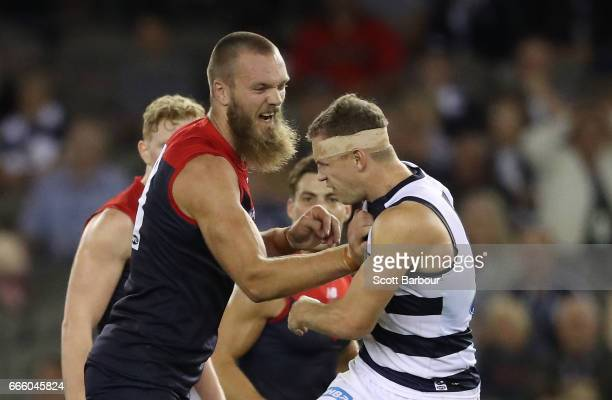 Joel Selwood of the Cats and Max Gawn of the Demons wrestle during the round three AFL match between the Geelong Cats and the Melbourne Demons at...