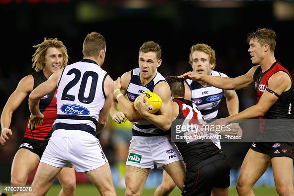 Joel Selwood of the Cats breaks a tackle during the round 10 AFL match between the Essendon Bombers and the Geelong Cats at Etihad Stadium on June 6...