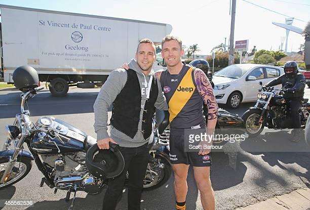 Joel Selwood of the Cats dressed as Jake King poses with former Richmond Tigers player Jake King after arriving on the back of his motorcycle at the...