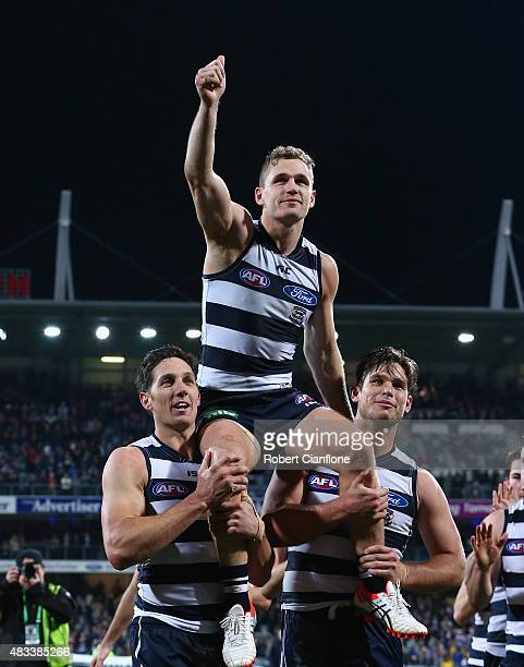 Joel Selwood of the Cats is chaired off by team mates fater playing his 200th match during the round 19 AFL match between the Geelong Cats and the...