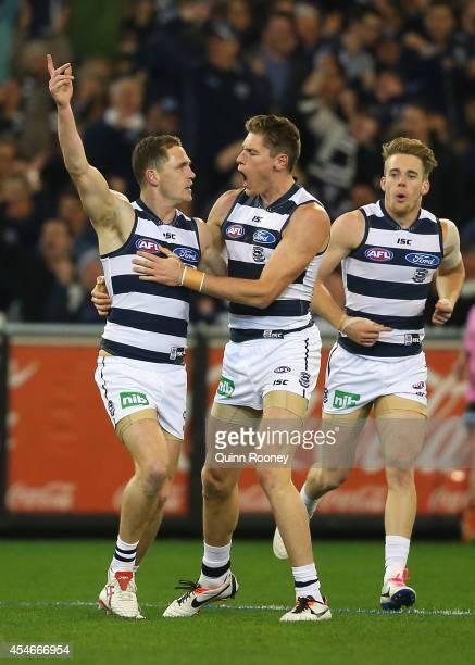 Joel Selwood of the Cats is congratulated by Mark Blicavs after kicking a goal during the AFL 2nd Qualifying Final match between the Hawthorn Hawks...