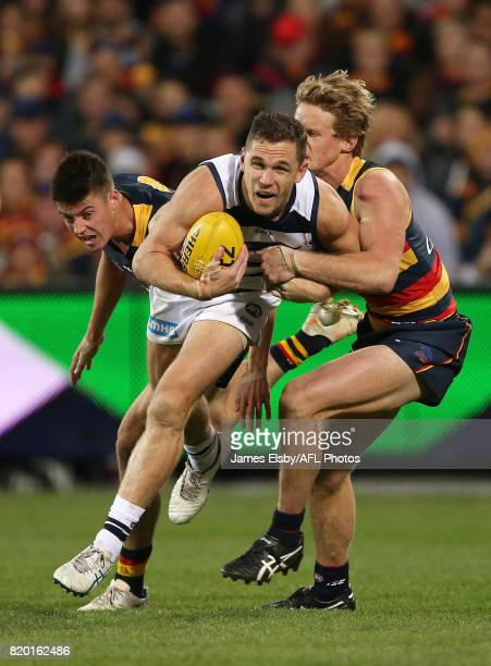 Joel Selwood of the Cats is tackled by Rory Sloane of the Crows during the 2017 AFL round 18 match between the Adelaide Crows and the Geelong Cats at...
