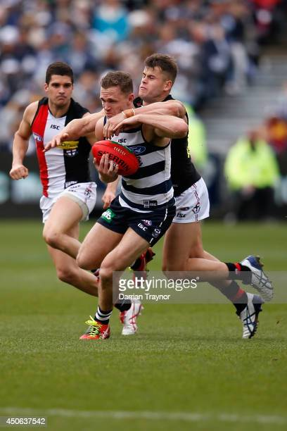Joel Selwood of the Cats is tackled high by Maverick Weller of the Saints during the round 13 AFL match between the Geelong Cats and the St Kilda...