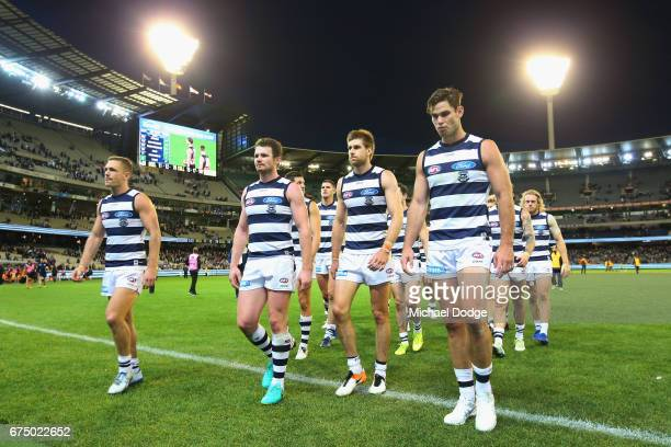Joel Selwood of the Cats Patrick Dangerfield Tom Lonergan and Tom Hawkins of the Cats lead the team out off after defeat during the round six AFL...