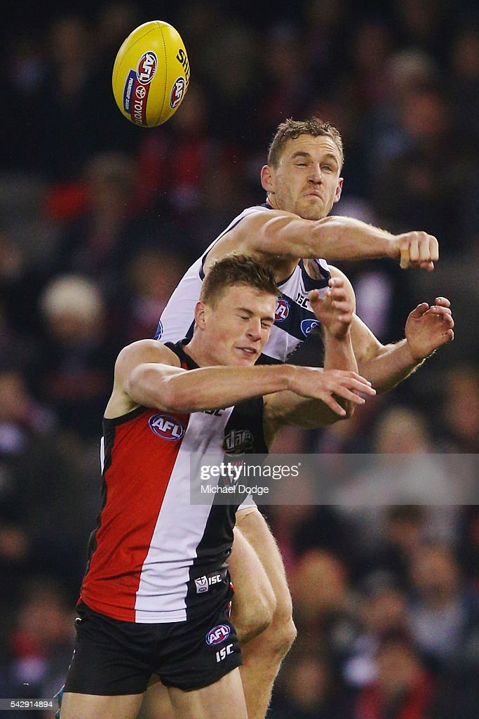 Joel Selwood of the Cats punches the ball from Jack Newnes of the Saints during the round 14 AFL match between the St Kilda Saints and the Geelong Cats at Etihad Stadium on June 25, 2016 in Melbourne, Australia.