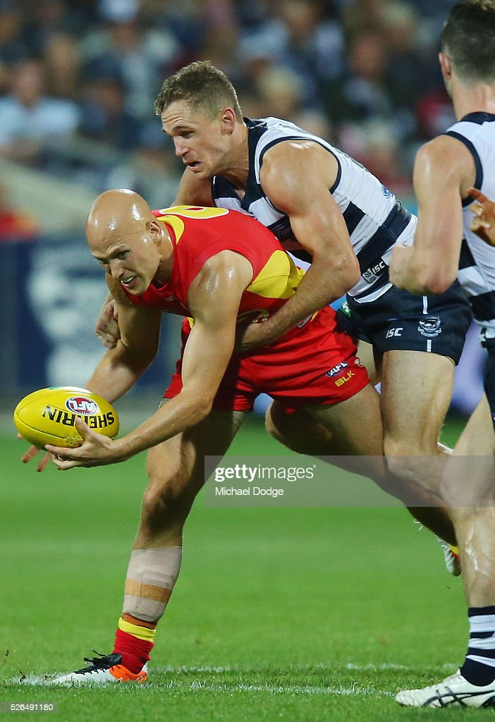 <a gi-track='captionPersonalityLinkClicked' href=/galleries/search?phrase=Joel+Selwood&family=editorial&specificpeople=4521436 ng-click='$event.stopPropagation()'>Joel Selwood</a> of the Cats tackles <a gi-track='captionPersonalityLinkClicked' href=/galleries/search?phrase=Gary+Ablett&family=editorial&specificpeople=206196 ng-click='$event.stopPropagation()'>Gary Ablett</a> of the Suns during the round six AFL match between the Geelong Cats and the Gold Coast Suns at Simonds Stadium on April 30, 2016 in Geelong, Australia.