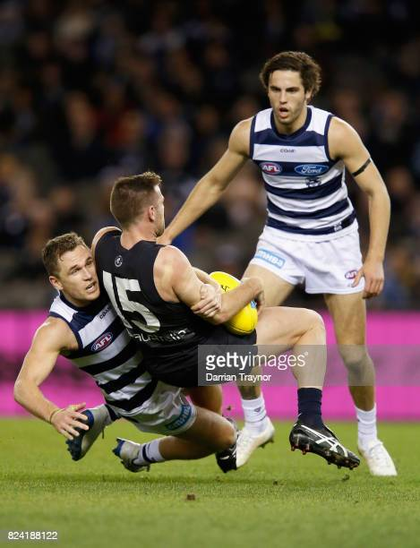 Joel Selwood of the Cats tackles Sam Docherty of the Blues during the round 19 AFL match between the Carlton Blues and the Geelong Cats at Etihad...