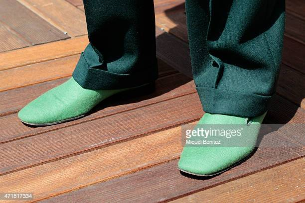 Joel shoe detail wears a set of jacket a striped shirt trousers and shoes costummade by Santa Eulalia Barcelona a Rolex wristwatch and green rimmed...