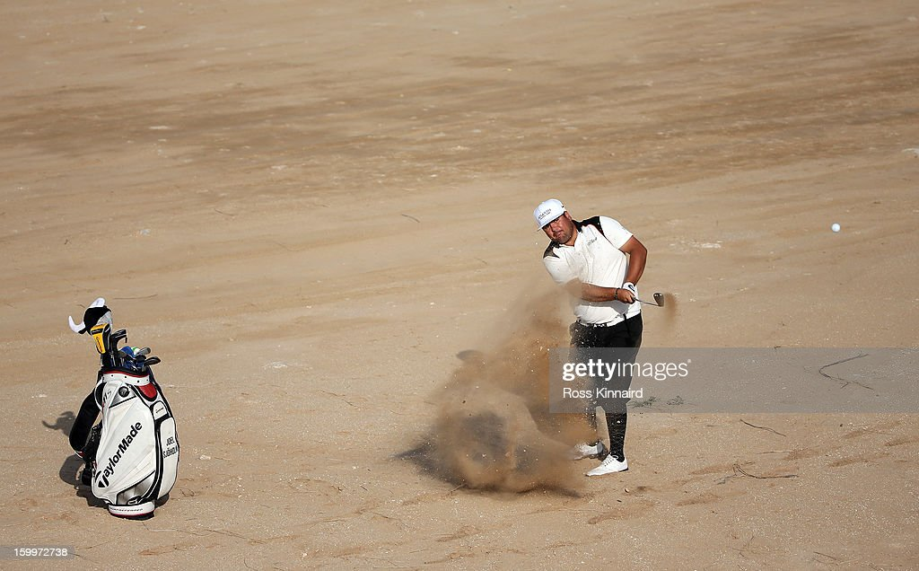 Joel Sjoholm of Sweden plays his second shot from the sand on the par three 16th hole during the second round of the Commercial Bank Qatar Masters at The Doha Golf Club on January 24, 2013 in Doha, Qatar.