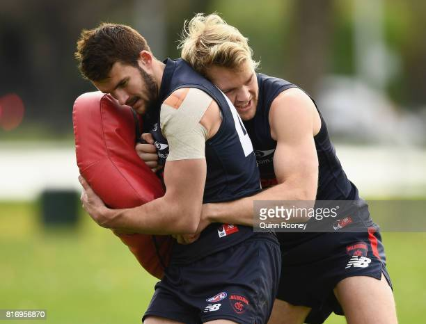 Joel Smith of the Demons is tackled by Jack Watts during a Melbourne Demons AFL training session at Gosch's Paddock on July 18 2017 in Melbourne...