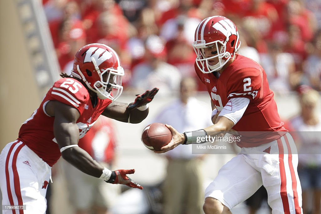 Joel Stave #2 of the Wisconsin Badgers hands off to <a gi-track='captionPersonalityLinkClicked' href=/galleries/search?phrase=Melvin+Gordon&family=editorial&specificpeople=8281473 ng-click='$event.stopPropagation()'>Melvin Gordon</a> #25 during the game against the Tennessee Tech Golden Eagles at Camp Randall Stadium on September 07, 2013 in Madison, Wisconsin.