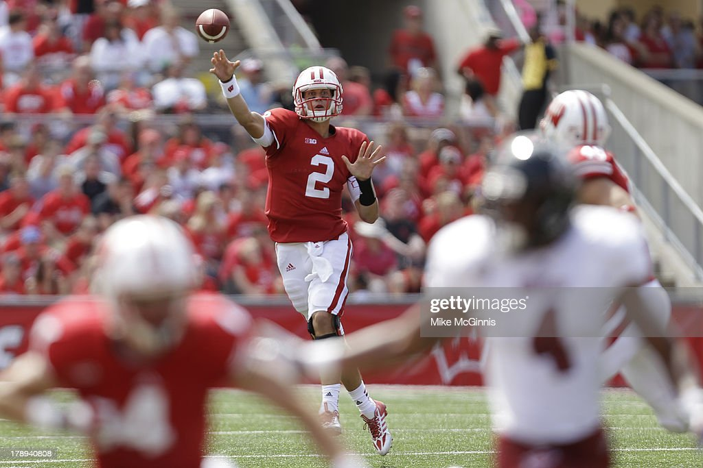 Joel Stave #2 of the Wisconsin Badgers makes the running pass during the game against the UMass Minutemen at Camp Randall Stadium on August 31, 2013 in Madison, Wisconsin.
