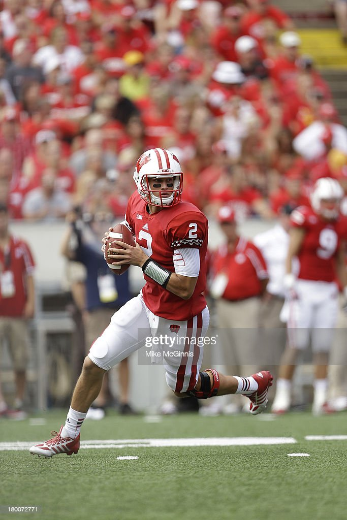 Joel Stave #2 of the Wisconsin Badgers scrambles out of the pocklet during the game against the UMass Minutemen at Camp Randall Stadium on August 31, 2013 in Madison, Wisconsin.