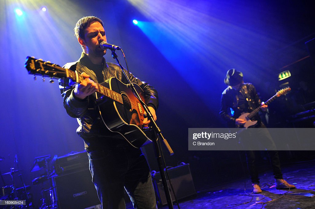 Joel Stoker and Lucas Crowther of The Rifles perform on stage at O2 Shepherd's Bush Empire on March 17, 2013 in London, England.