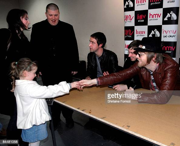 Joel Stoker Luke Crowther and Grant Marsh of The Rifles sign CD for fans at HMV on January 26 2009 in Manchester England