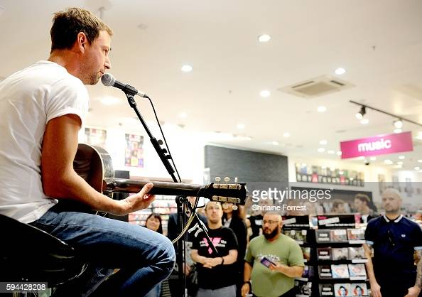 Joel Stoker of The Rifles performs live and meets fans to celebrate the launch of their album 'Big Life' at HMV Manchester on August 23 2016 in...
