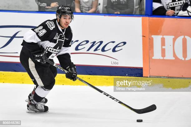 Joel Teasdale of the BlainvilleBoisbriand Armada skates the puck against the RouynNoranda Huskies during the QMJHL game at Centre d'Excellence Sports...