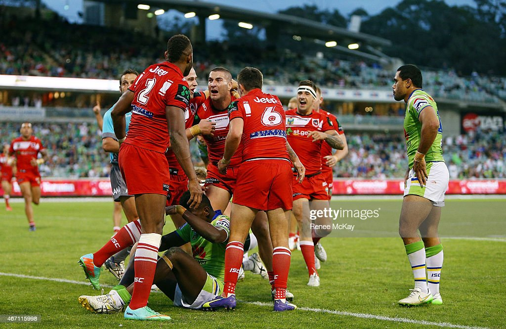Joel Thompson of the Dragons celebrates his try with team mates during the round three NRL match between the Canberra Raiders and the St George...