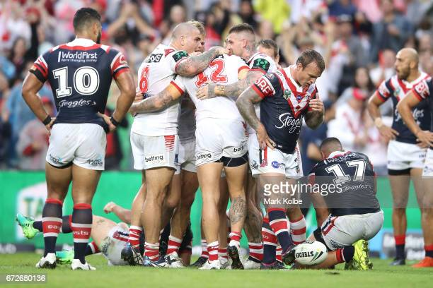 Joel Thompson of the Dragons celebrates with his team mates after scoring a try during the round eight NRL match between the Sydney Roosters and the...