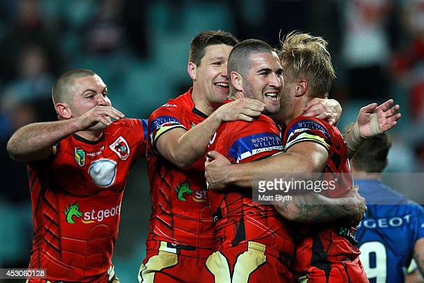Joel Thompson of the Dragons celebrates with team mates after scoring a try during the round 21 NRL match between the Sydney Roosters and the St...