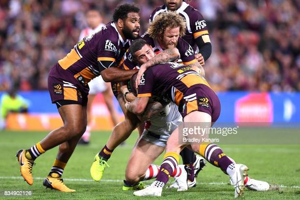 Joel Thompson of the Dragons is tackled during the round 24 NRL match between the Brisbane Broncos and the St George Illawarra Dragons at Suncorp...