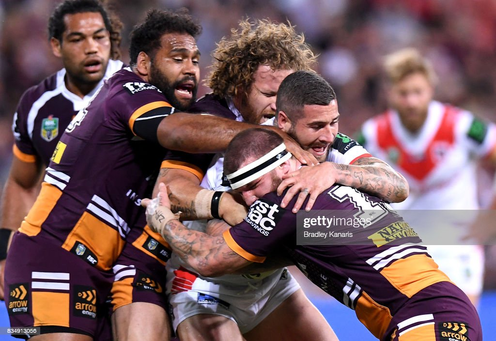 Joel Thompson of the Dragons is wrapped up by the defence during the round 24 NRL match between the Brisbane Broncos and the St George Illawarra Dragons at Suncorp Stadium on August 18, 2017 in Brisbane, Australia.