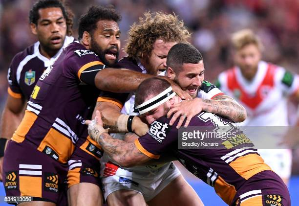 Joel Thompson of the Dragons is wrapped up by the defence during the round 24 NRL match between the Brisbane Broncos and the St George Illawarra...