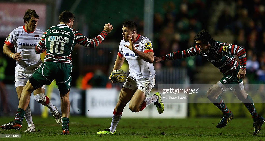 Joel Tomkins of Saracens beats the tackle from Matt Smith (R) of Leicester during the Aviva Premiership match between Leicester Tigers and Saracens at Welford Road on February 23, 2013 in Leicester, England.