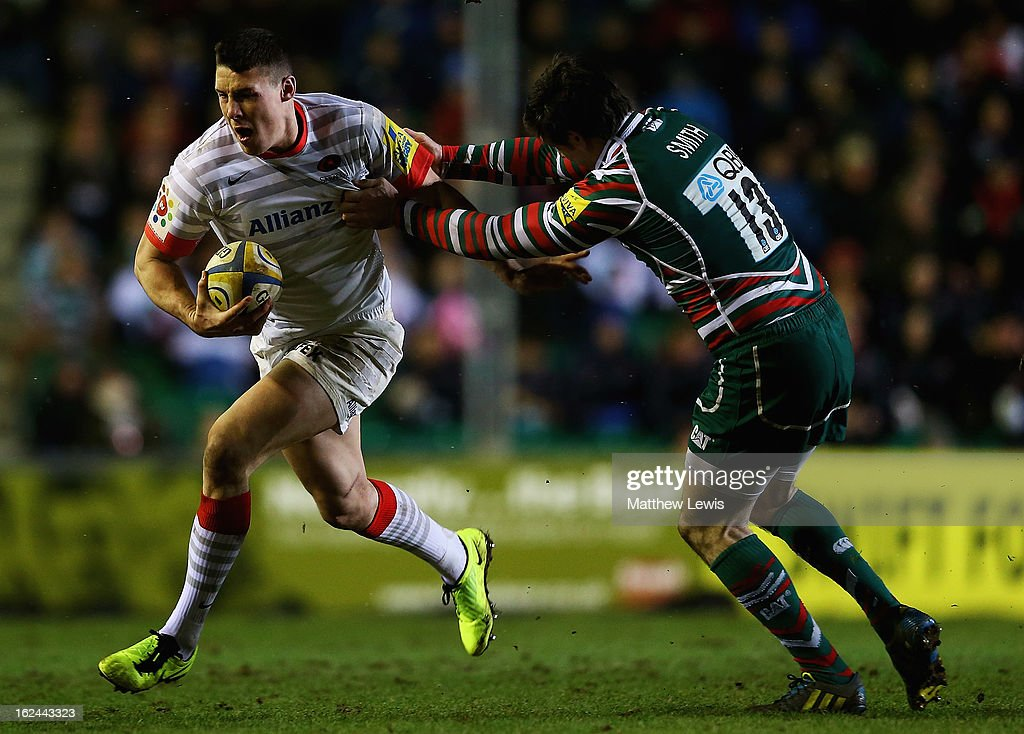 Joel Tomkins of Saracens holds off Matt Smith of Leicester during the Aviva Premiership match between Leicester Tigers and Saracens at Welford Road on February 23, 2013 in Leicester, England.